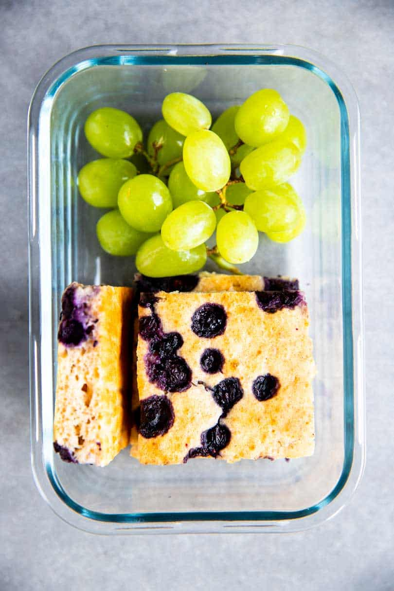 container with sheet pan blueberry pancakes and grapes