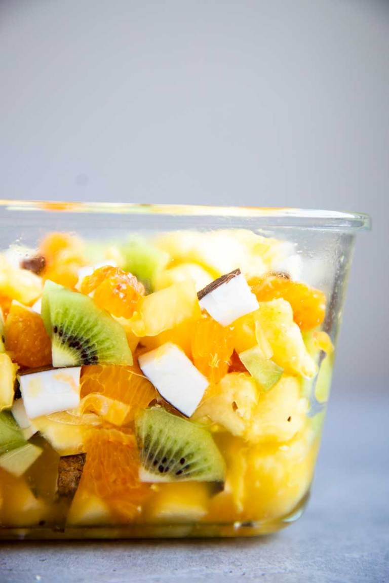 container filled with tropical fruit salad
