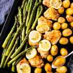 dark sheet pan with chicken, asparagus and potatoes