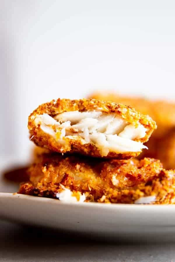 stack of crispy oven fried fish pieces on a plate