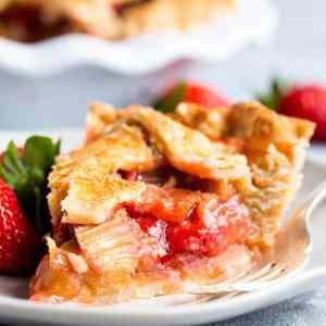 slice of strawberry rhubarb pie on a plate