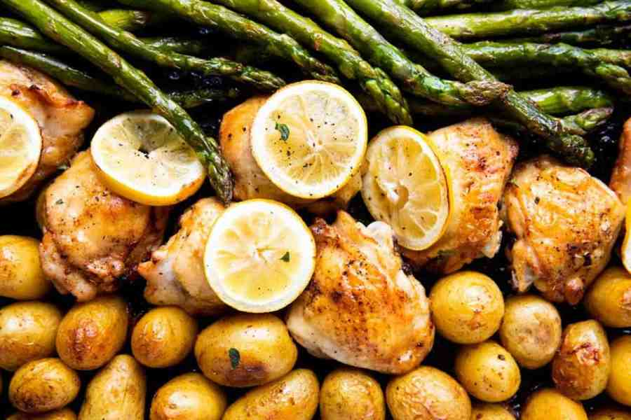 close up photo of chicken, potatoes, asparagus and lemon slices