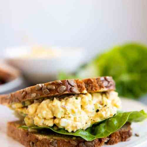 greek yogurt egg salad sandwich on a platter