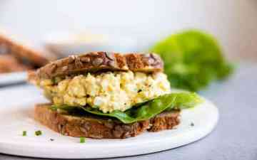 sandwich made with greek yogurt egg salad on a plate