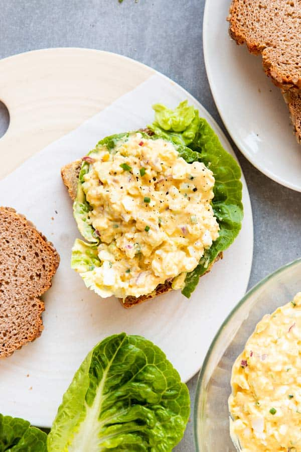 bread with lettuce and egg salad to make an egg salad sandwich