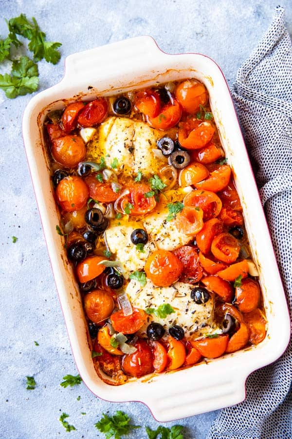 baking dish filled with mediterranean baked cod