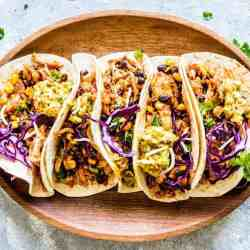 chicken tacos on wooden platter