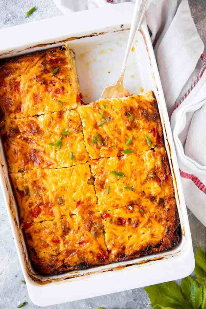 sliced hash brown breakfast casserole in a white dish