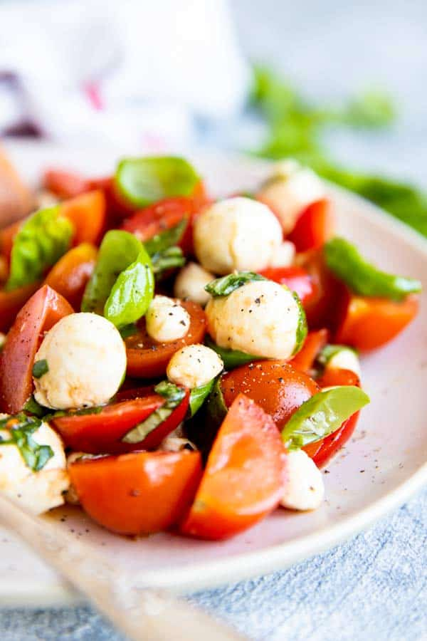 close up photo of caprese cherry tomato salad