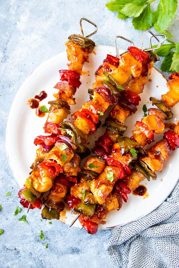 plate with pineapple bbq chicken kabobs