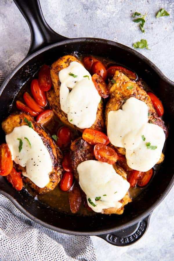cast iron skillet with balsamic glazed caprese chicken