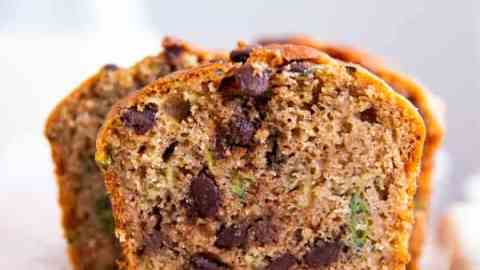 slice of healthy chocolate chip zucchini bread on a chopping board