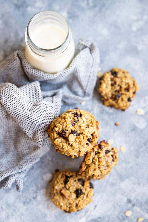 several healthy breakfast cookies on the table with a napkin and a bottle of milk