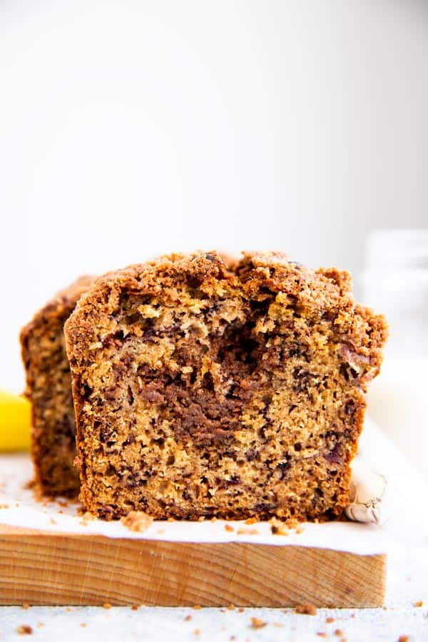 slice of banana bread with cinnamon filling on a wooden board