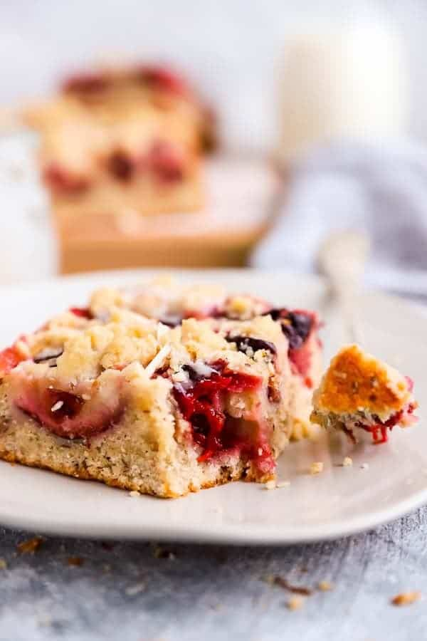 slice of German plum cake on a plate with a fork