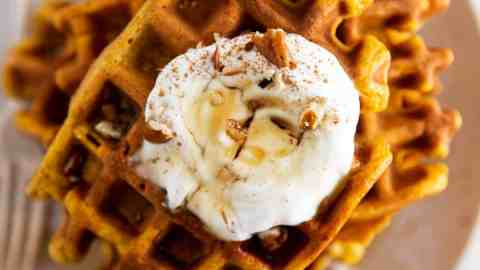 close up of pumpkin waffle stack on plate