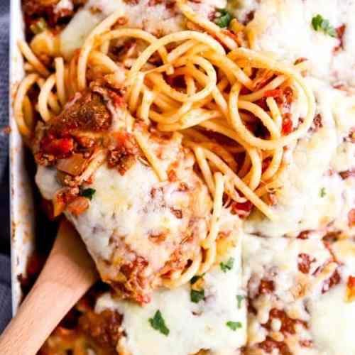 close up photo of a scoop of spaghetti casserole in the dish