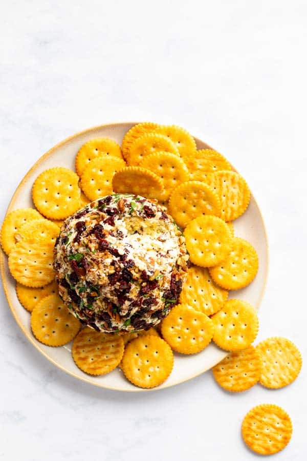 top down view on a cheeseball with ritz crackers on a plate