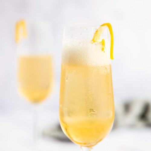 two glasses of st Germain champagne cocktail in a bright light