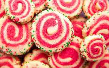 pile of pinwheel sugar cookies in holiday colors