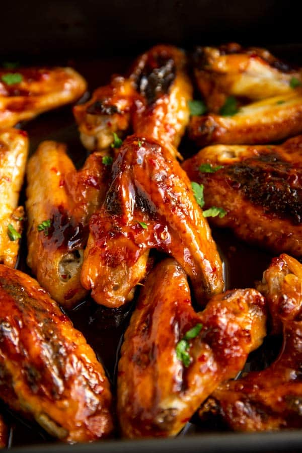 close up photo of sticky glazed chicken wings
