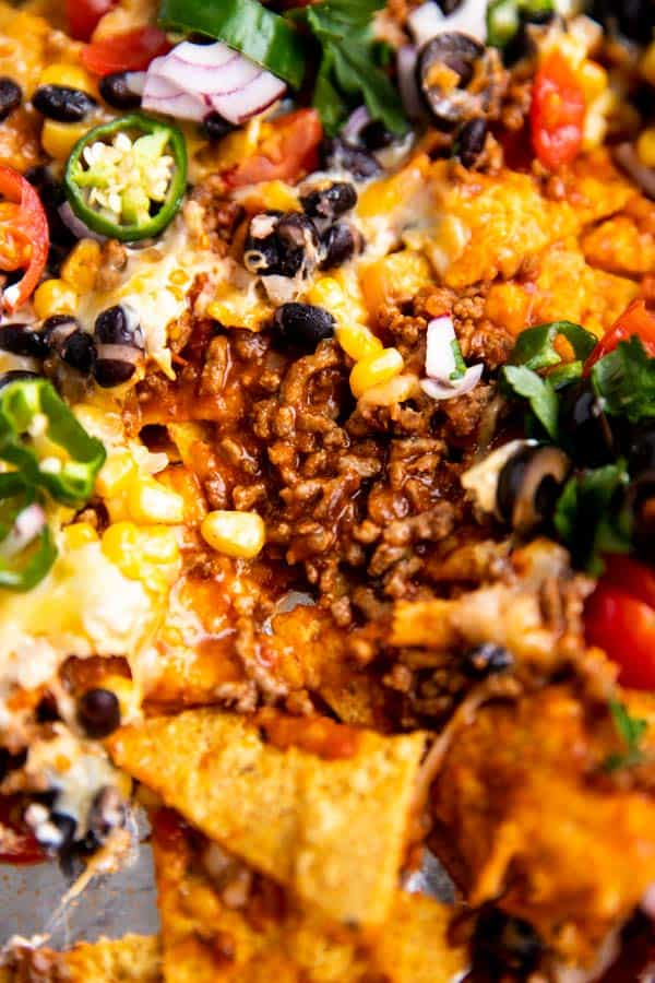 close up photo of nacho toppings