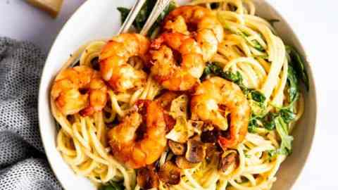 top down view on a plate with cache e Pepe pasta and shrimp