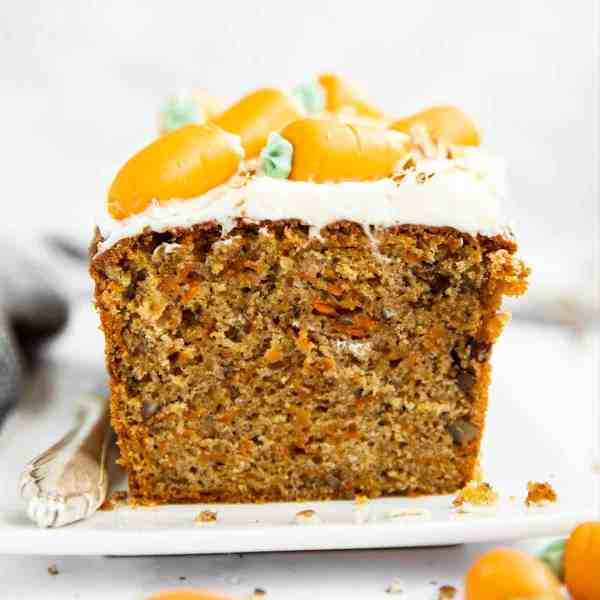 image of sliced carrot cake loaf on a white platter