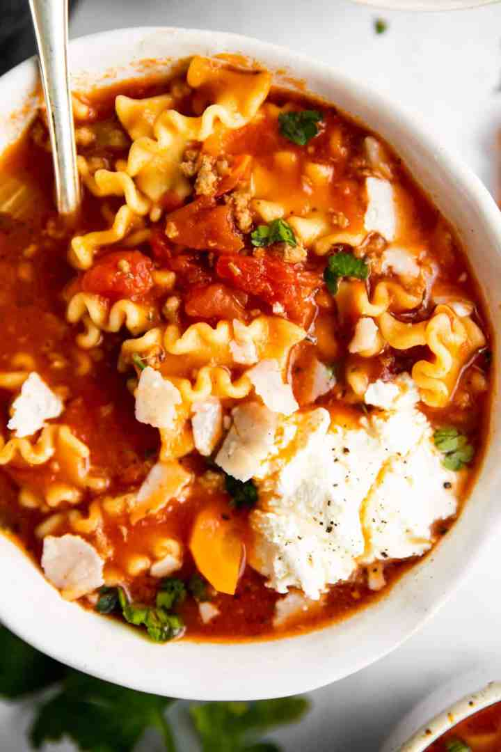 close up photo of bowl with lasagna soup