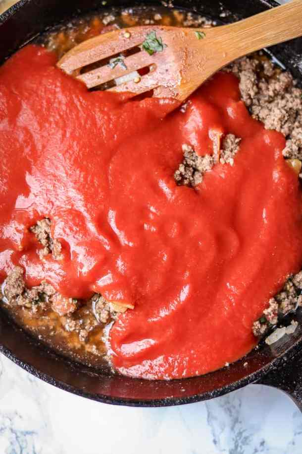 Beef Bolognese Recipe. Savory Thoughts. Beef Bolognese in a skillet