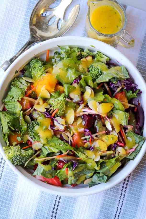 Scrumptious Simple Garden Salad Recipe that's made with fresh fruits and vegetables. The salad is dressed with a creamy, delicious, mango dressing to create a perfect side dish. It is perfect to serve as a main dish and is great for detoxing the body. Simple Garden Salad Recipe | Fresh Garden Salad Recipe | Savory Thoughts #simplegardensaladrecipe #gardenrecipe #freshgardensaladrecipe #mangodressing