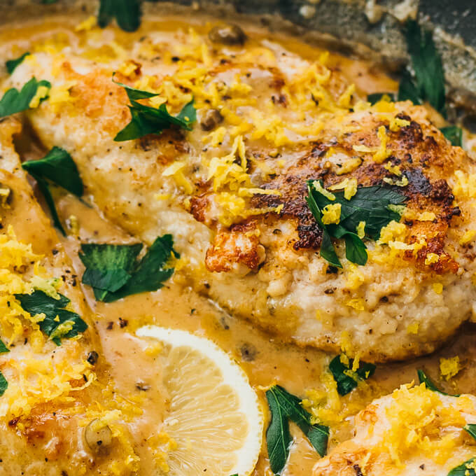 This lemon chicken piccata is served with capers in a creamy butter sauce. It's a healthy, low carb 30-minute skillet dinner.