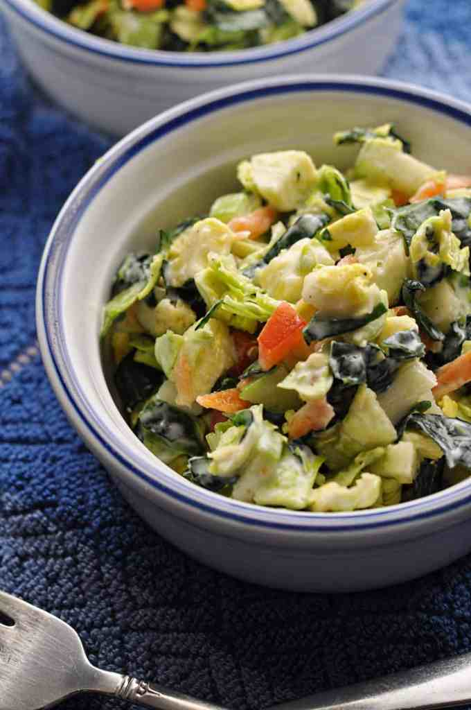 Shaved Brussel Sprouts Salad recipe with honey lime dressing in a bowl