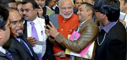 Gujarat Chief Minister Narendra Modi being mobbed by NRI fans at a Pravasi Bharatiya Divas function in New Delhi