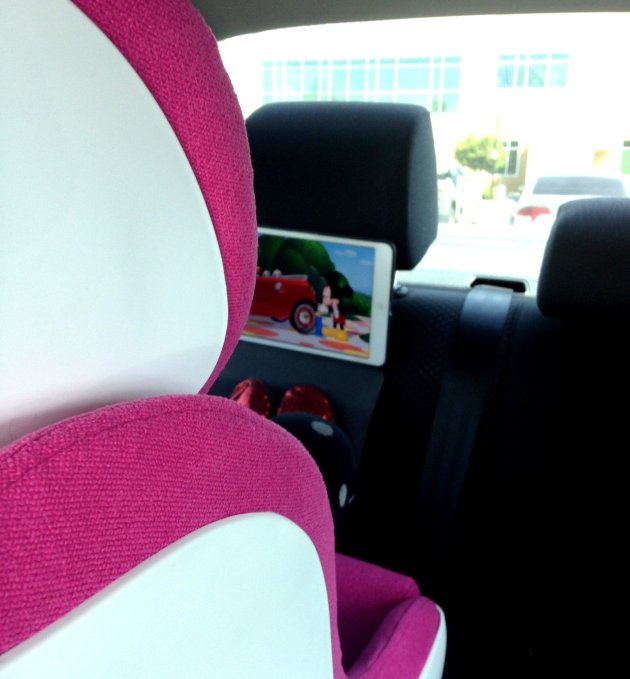 The ShowFolio is a life saver on long car rides. The hooks attach to the headrest fairly easily. I could only get one hook on my back headrest, but it was secure enough to hold the iPad alone, with a straight screen.
