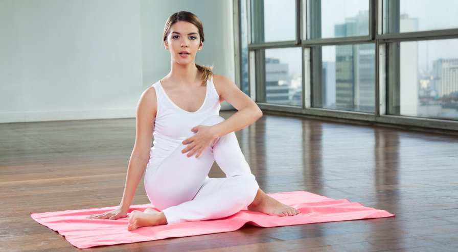 Young Woman Practicing Yoga At Gym