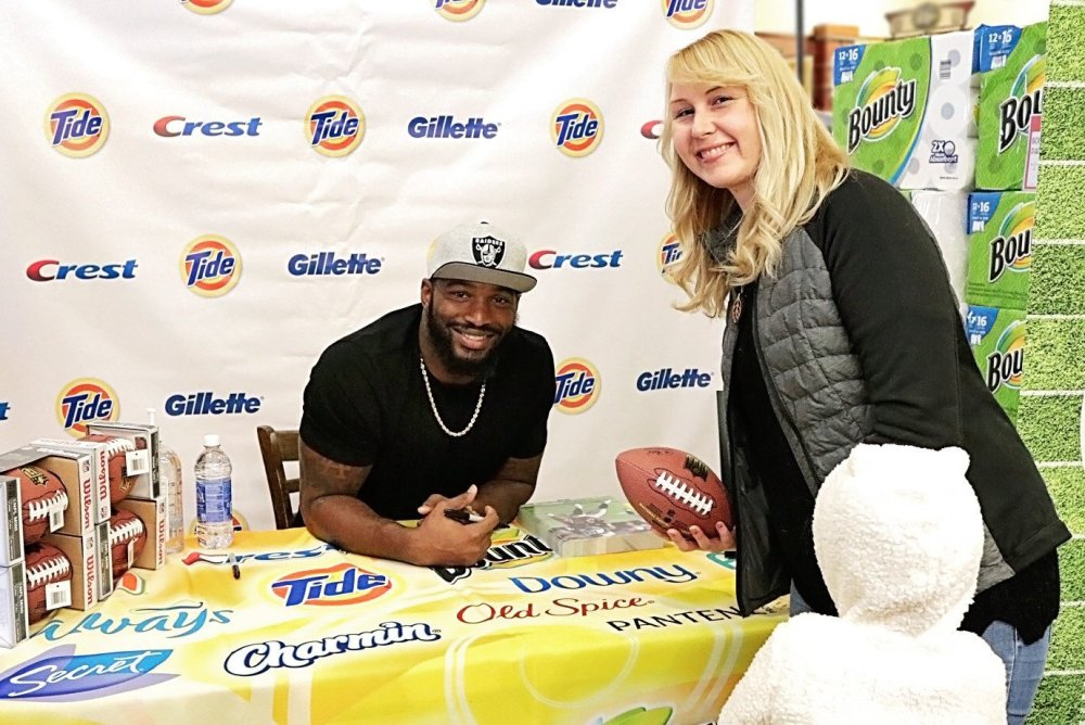 Picture of Shari meeting Marcel Reece