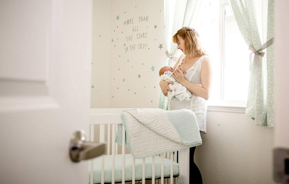 Peeking into gray and mint nursery room