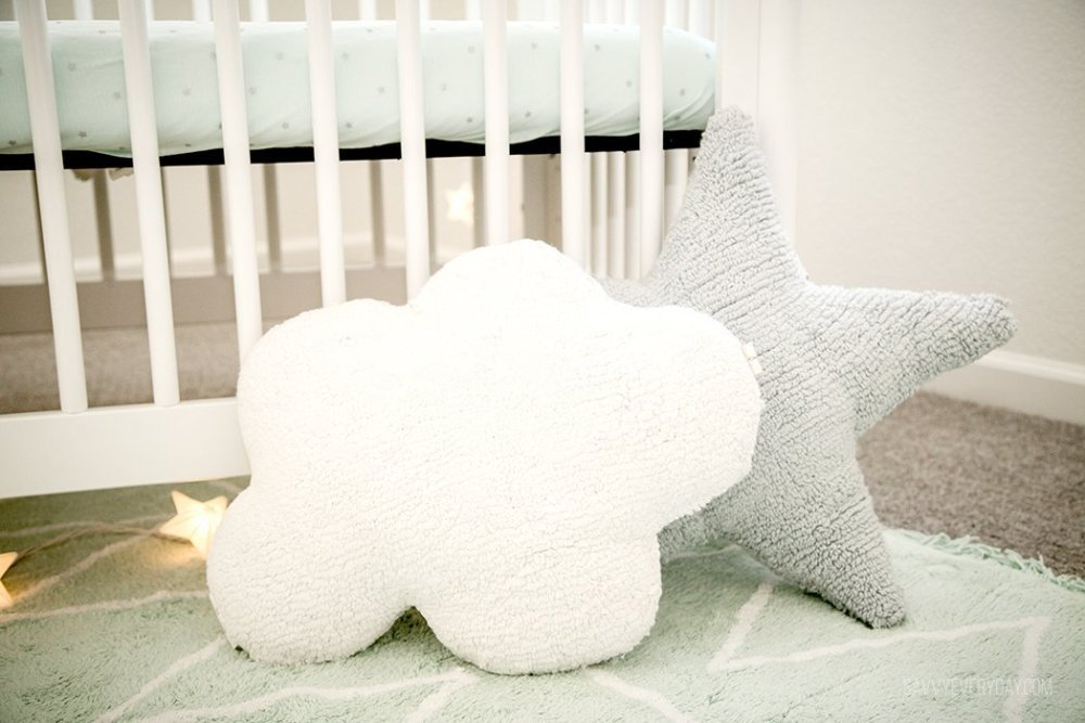 cloud and star pillows on the floor