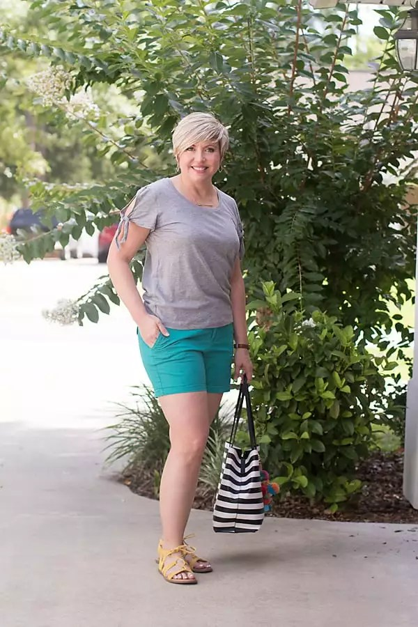 neutral tee and colored shorts outfit