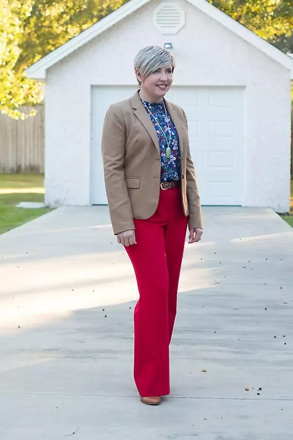 Trouser cut red pants with camel blazer and floral print top