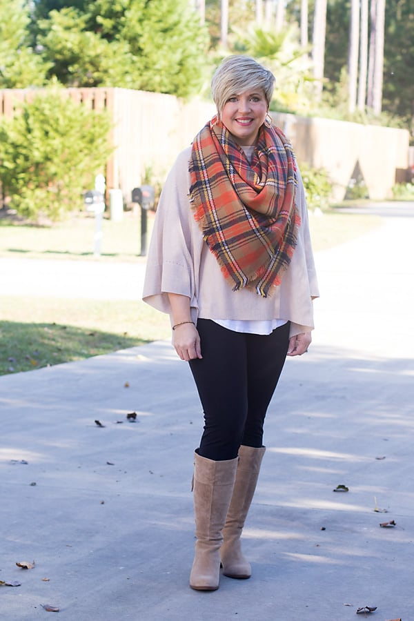 fashion blogger wearing blanket scarf, poncho and leggings