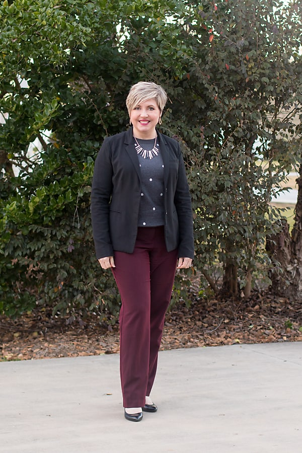 office outfit with black blazer, grey dot sweater and burgundy pants