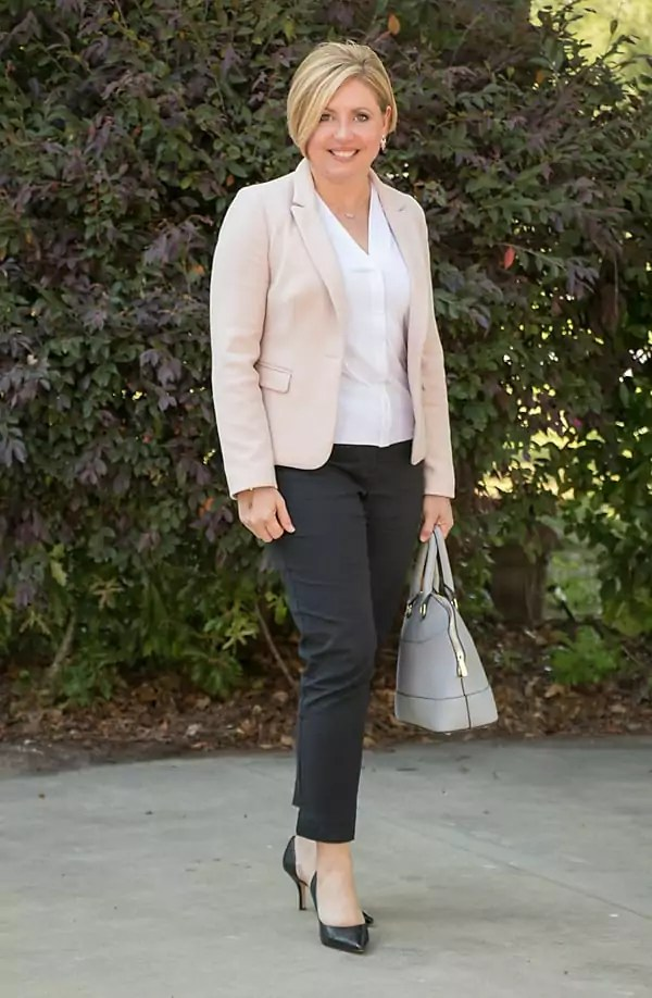 Blush blazer and black ankle pants office outfit