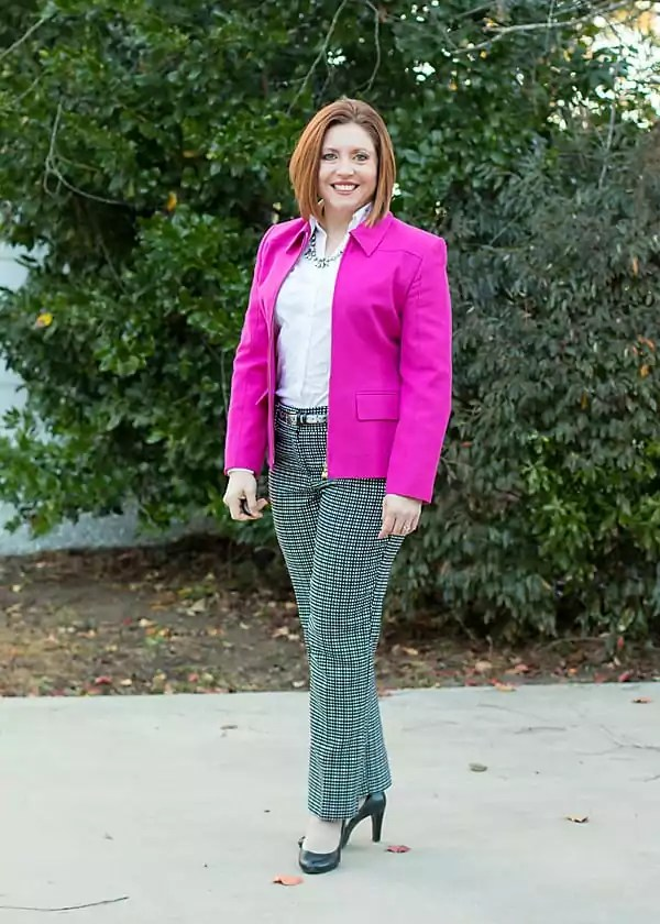 Office outfit with hot pink, white button up and black and white grid print pants