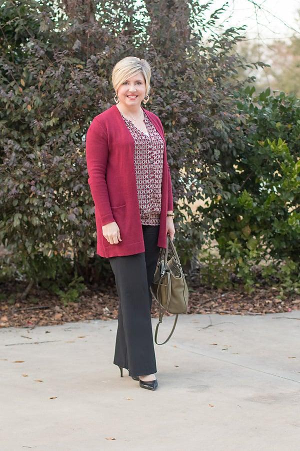 Burgundy cardigan with burgundy print blouse and black slacks