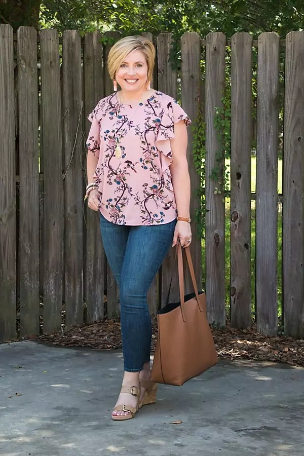 Ruffle floral top to create volume on top to slim wide hips.