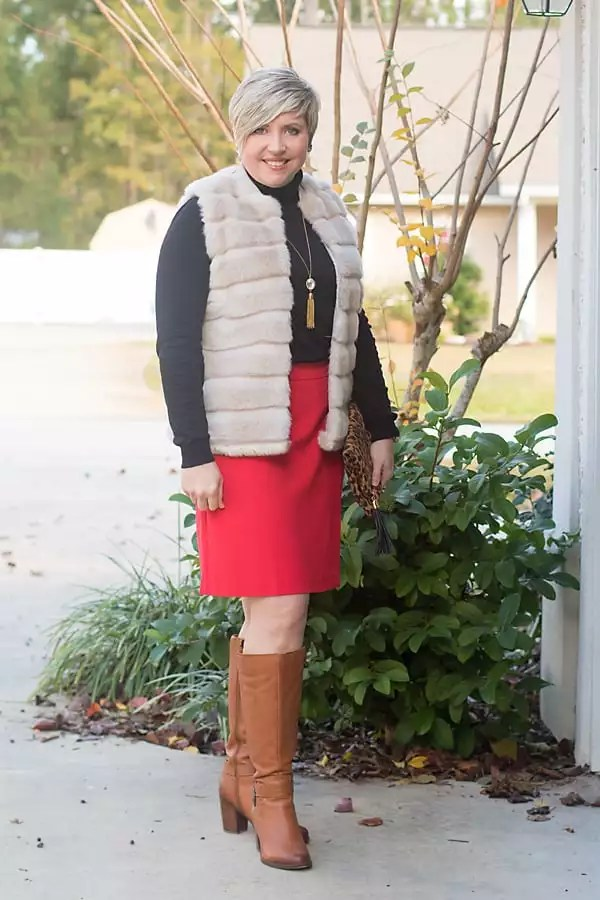 Modest Valentine's Date night outfit with red skirt, black sweater and fur vest.
