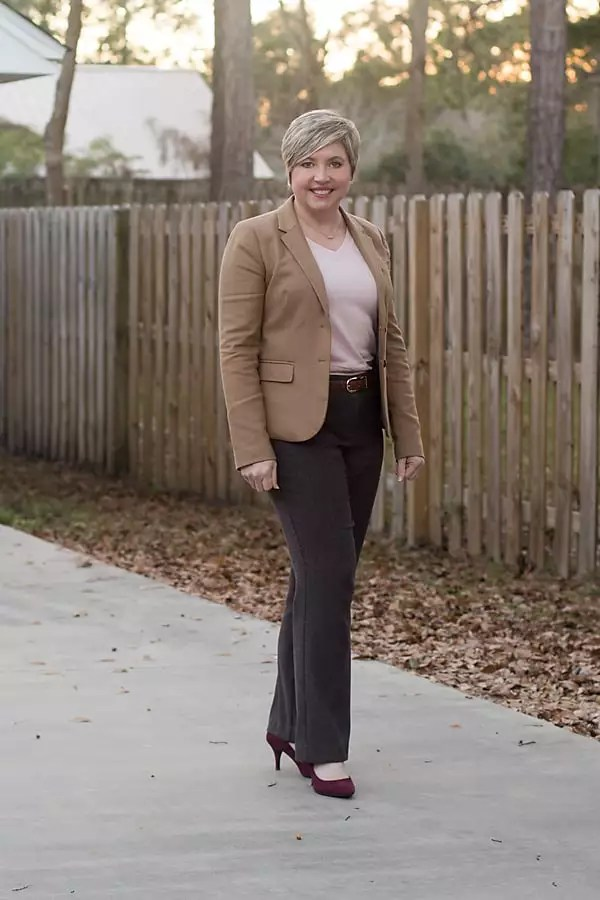 brown pants, camel blazer and pink sweater winter office outfit