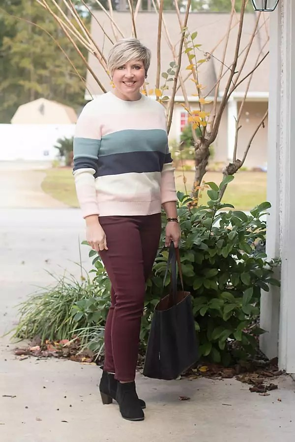 stripe color block sweater with burgundy jeans and black booties